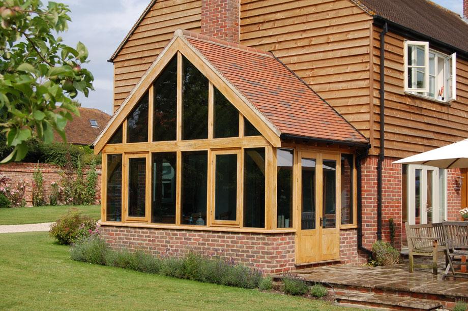 Oak green oak timber framed garden rooms for Wooden garden rooms extensions